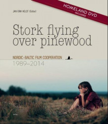 Stork flying over pinewood (Innbundet)